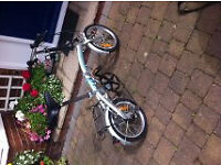 Folding Bike with Shimano Gears, complets with bag to transport it.