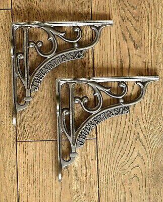 A pair of cast iron antique style J Duckett & Son brackets shelf brackets AL80