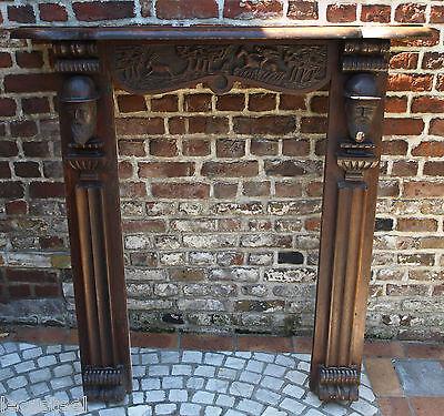 magnifique façade de cheminée en bois sculpté de têtes - art populaire