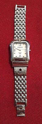 Akribos XXIV Silver Women's Watch. Diamond Dial. AK528SS Buckle Bracelet. Works