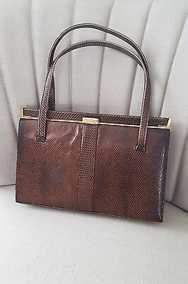 1950s Handbags, Purses, and Evening Bag Styles MAPPIN AND WEB Vintage Brown Lizard Top Handle Bag (M) $178.63 AT vintagedancer.com