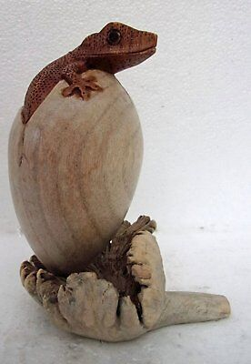 Unusual Hand Carved Gecko Egg Wooden Lizard hatching from Egg on Parasite Wood