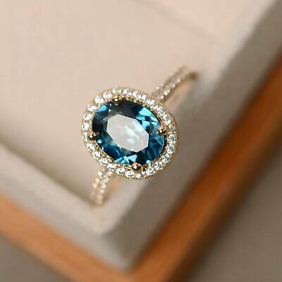 2.45Ct Oval Cut London Blue Topaz Halo Engagement Ring In 14K Yellow Gold Finish