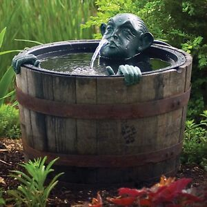 Pond fountain decorative man in barrel pump water feature for Pond stuff for sale