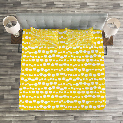 yellow and white quilted bedspread and pillow