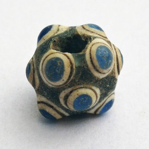 A warty cylindrical bead, 7 - 9 century