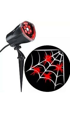 Halloween LED Projection Plus Whirl-A-Motion Static Red Spider with White Web](A Halloween Spider Web)