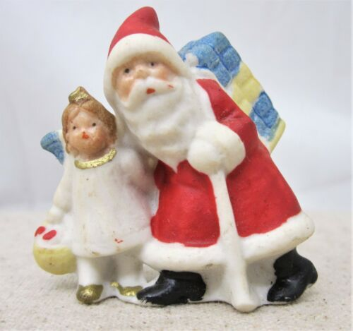Vintage Bisque Santa And Snow Angel and Bag of Gifts German marked Germany