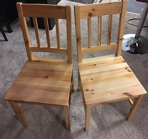 A pair of wood chairs
