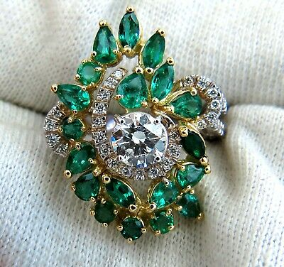 GIA certified 4.06ct. Emerald & Diamonds Cocktail Cluster ring 18kt 5