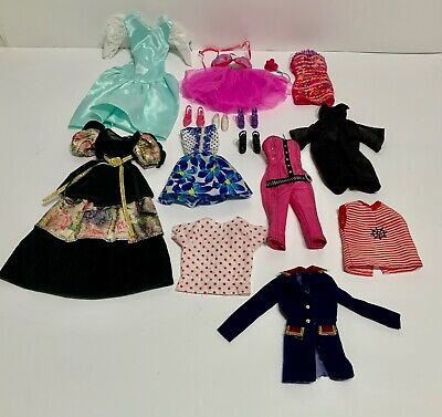 LOT OF ELEVEN PIECES OF BARBIE CLOTHING AND ACCESSORIES