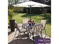 Patio 4 Cushioned Armchair, Glass Top Table, Wind Up Parasol