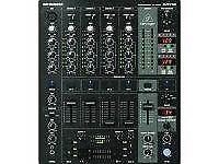 The Behringer DJX750 Professional 5-Channel DJ Mixer with Flight Case and Effects unit.