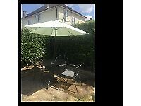 Steel garden table with 4 chairs and parasol