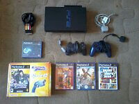 Playstation 2 console plus GCon2 Gun and games