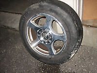 Two Ford Mustang Aluminum Rims and Tires