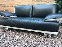 Dfs leather 2 seater sofa and footstool