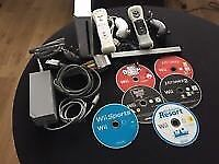 White wii console with motion plus and games