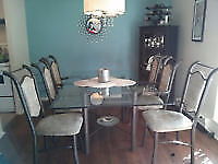 Glass dining room table $175 with 6 chairs!!