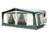 Bradcot 870cm Awning in green. Little used in very good clean condition. Fibre glass poles.