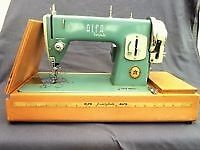 Alpha electric sewing machine with needles, fittings, Zig Zag attachment on wood base with cover