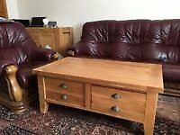 solid oak coffee table - very heavy with 2 deep drawers