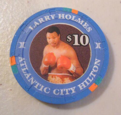 CASINO CHIP $10. HILTON HEAVYWEIGHT CHAMP LARRY HOLMES ATLANTIC CITY