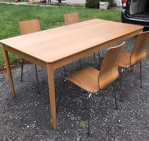 SOLID TEAK dining table and 4 chairs With leaf