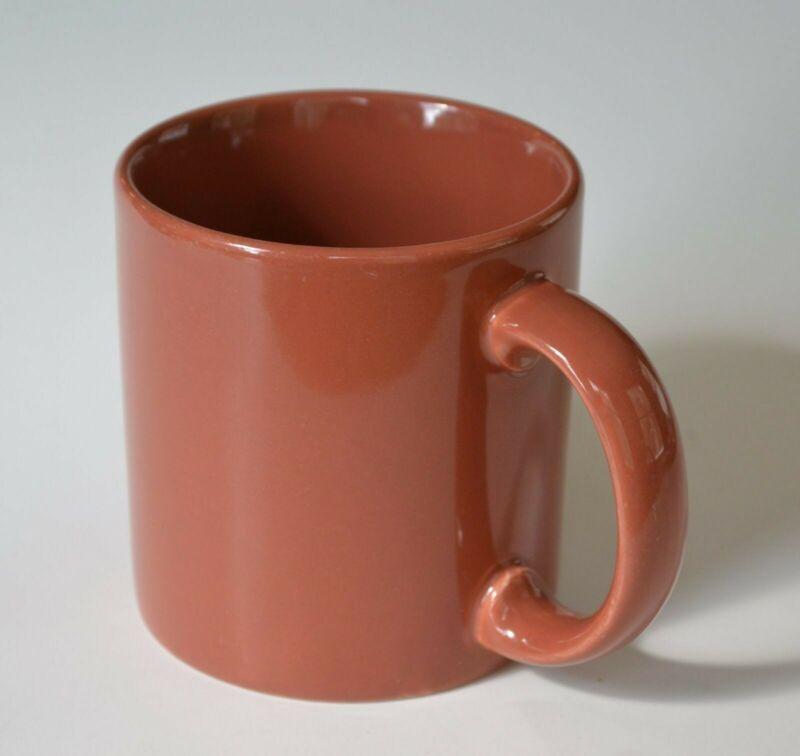 Orange Stoneware Mug (Cup), says England on the bottom and has a maker's mark