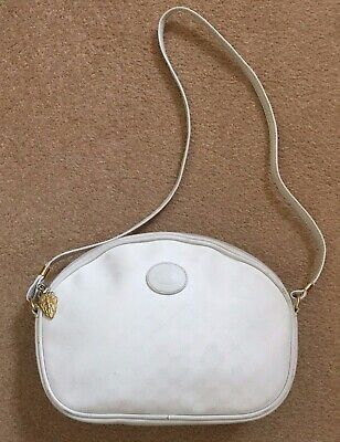 AUTHENTIC  VINTAGE WHITE GUCCI BAG, ZIPPER CHARM ATTACHED, HAS SERIAL NO.