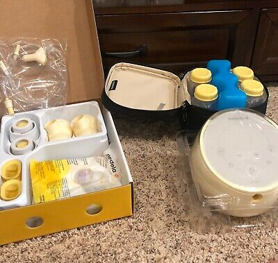 medela sonata new.sealed open to show exact pictures include everything in pic.