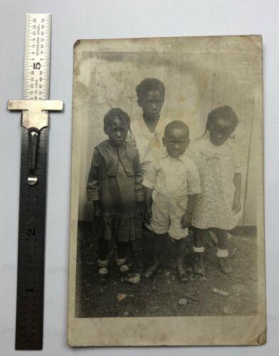 Black Americana Vintage 1915 real photo postcard of 4 black children