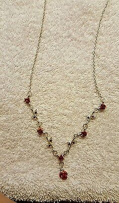 silver and metal red rose necklace