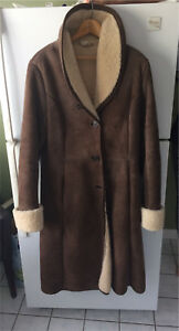 Women's full length sheepskin leather coat. Size M