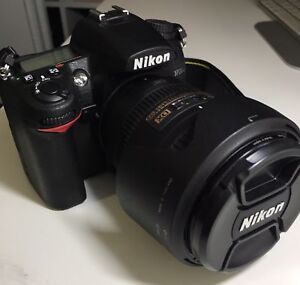 Used-Nikon DSLR D7000 body with lens package