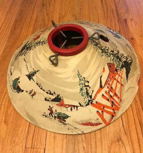 Vintage Metal Painted Christmas Tree Stand with snow/sledding depiction