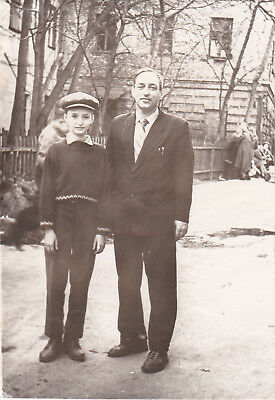 1950s Handsome young boy in hat with father man fashion old Russian Soviet photo