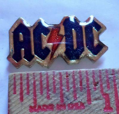 Vintage AC/DC logo pin collectible old rock band music pinback memorabilia