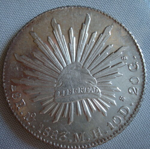 Mexico 8 Reales Silver Mo.1883 M.H About Una please see the coin.