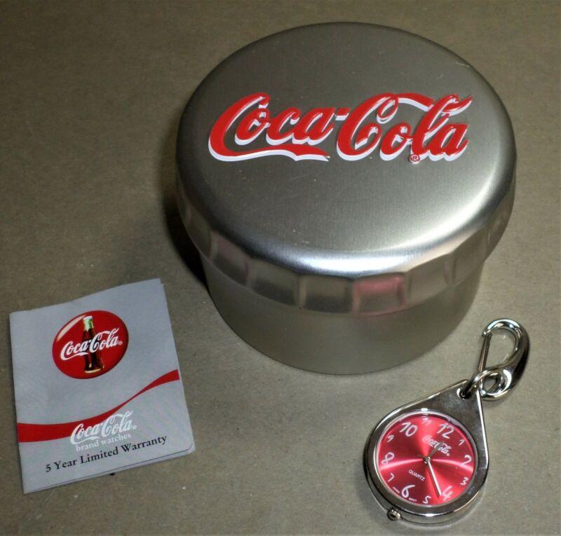 Coca Cola Pendant / Key Fob Watch in Embossed Metal Case. 2002, Model CC 5017