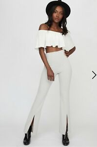 Light grey flare pants with front slit