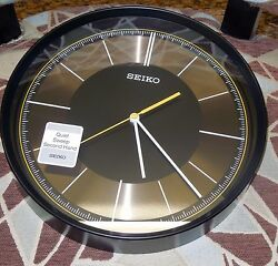 SEIKO BLACK CASE 12 IN DIAMETER  WALL CLOCK W/ QUIET SWEEP SECOND  QXA612KLH