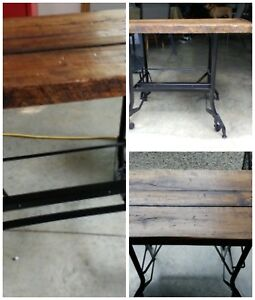 Old antique school desk with wooden wheels that drop down.