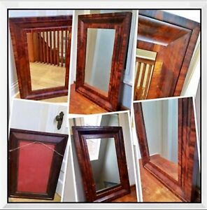Flame Mahogany Antique Empire mirror dating back to the 1830's.