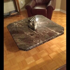 Solid marble coffee table on pedestal base.