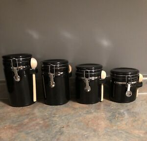 USED 4 black canisters
