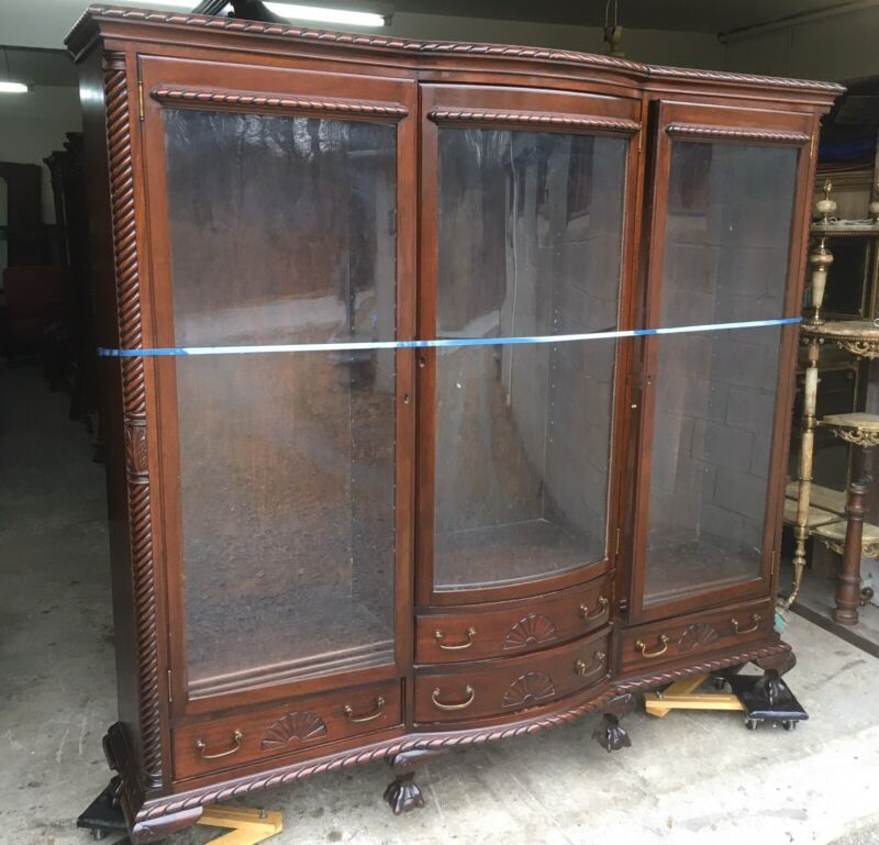 MAHOGANY CARVED TRIPLE DOOR BOOKCASE