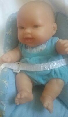 """9"""" BERENGUER VINYL BLUE EYED BOY WITH 2 TEETH, ORIGINAL CLOTHES & PADDED SEAT"""