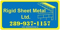 Flat roofing sheet metal worker and apprentice