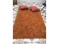 Orange rug with cushions